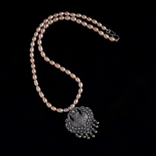 Handcrafted silver pendant with fresh water pearls